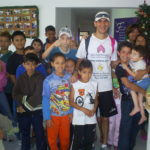 Shoe donation to Brasilian children by a member of Cia Athletica