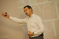 Ray Algar, MD of Oxygen Consulting on stage during a business presentation