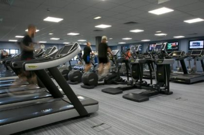 Image of men and women running on treadmills s