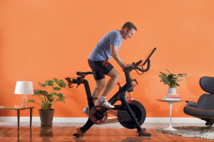 John Foley – CEO Peloton riding one of their bikes