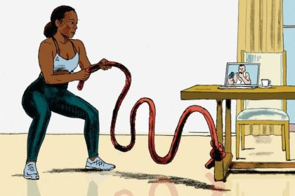 Black woman using a training battle exercise rope tied to her kitchen table